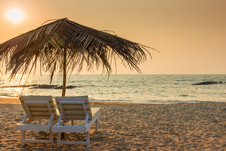 loungers: beautiful empty beach and a pair of sun loungers Stock Photo