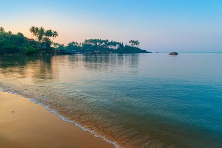 sea scene: morning sun rays on a beautiful beach Stock Photo