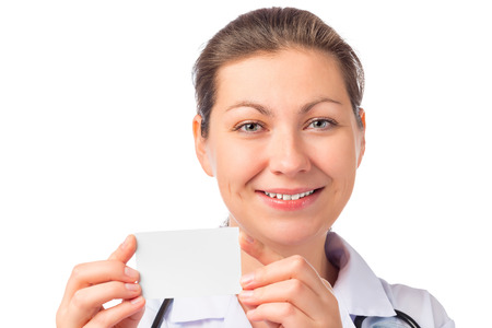 nurse and clean business card in her hands on white background photo