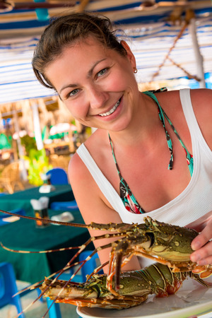 raw lobster: girl holding a raw lobster and smiling