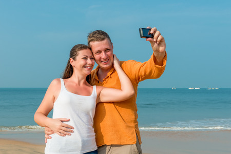 family memories: couple photographed in memory on the background of the sea