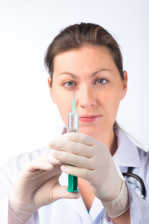 nurse gloves: portrait of a nurse with a syringe in gloves
