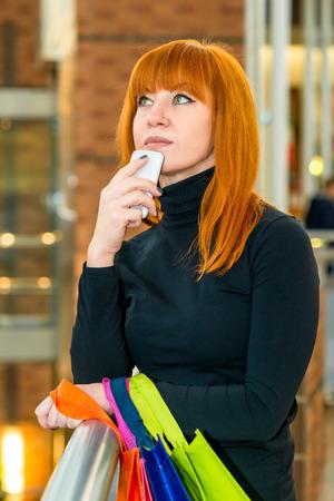 spent: Shopaholic in a shopping center considers spent money