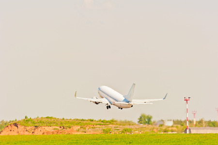passenger aircraft: white passenger aircraft takes off from the strip
