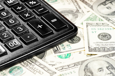 earned: counting profits earned on the calculator Stock Photo
