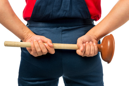 plunger: Plumber in working clothes with a plunger Stock Photo
