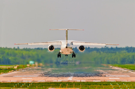 departing: Rear view of an aircraft departing from the airport