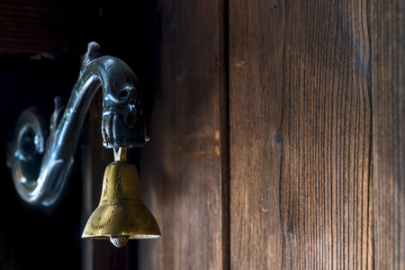 singing bells: brass bell at the door to the old style Stock Photo