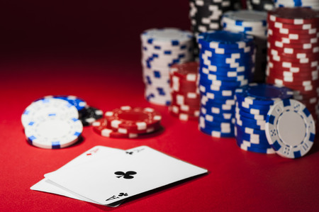 poker: cards and poker chips on a red cloth