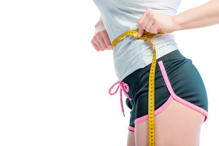 centimeter on a slender female waist