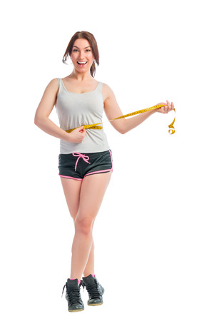 emaciated: emaciated happy girl with centimeter at the waist Stock Photo
