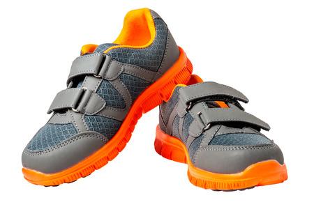 white trim: children sneakers with bright orange trim on a white background