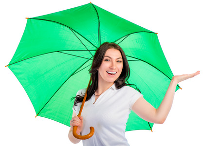 portrait of a smiling happy girl with a green umbrella isolated Imagens