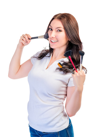 gets: Girl gets powder on the cheek with a brush Stock Photo