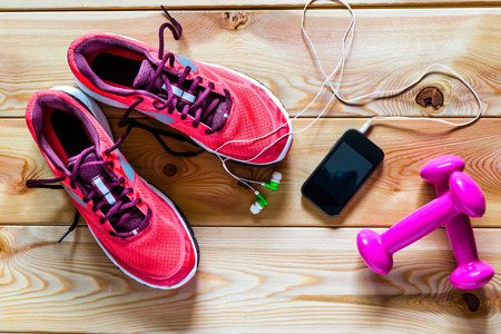 gym clothes: sports objects. photography on wooden boards