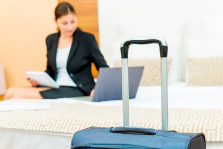 business trip: woman working on a business trip at the hotel