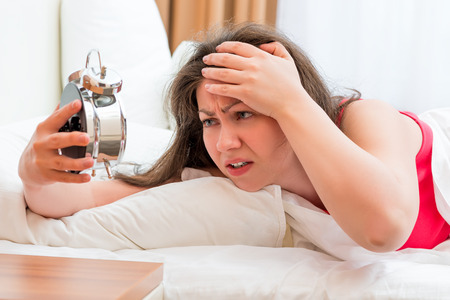 frustrated woman trying to sleep with insomnia Stock Photo