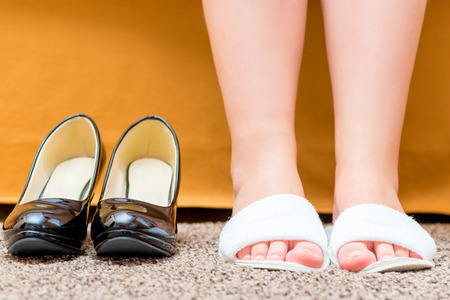 comfortable: female feet shod in comfortable slippers closeup