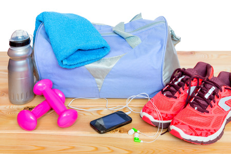 gym clothes: Accessories gymnastics for women on wooden boards close up Stock Photo