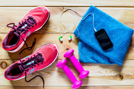 exercise equipment: Womens running shoes and dumbbells for training Stock Photo