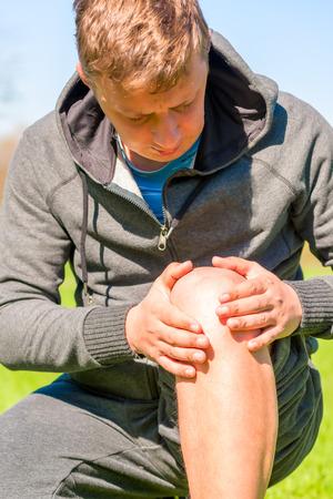 diseased: Athlete inspects diseased knee while jogging