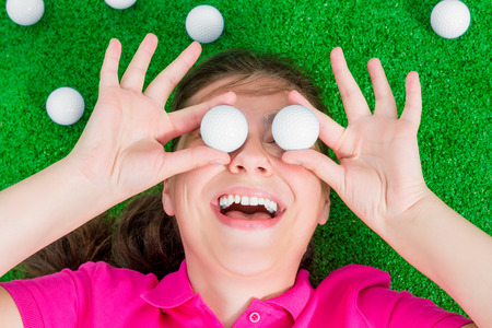 comical: comical portrait of a girl with golf balls