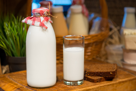 bottle and a glass of cows milk Stock Photo