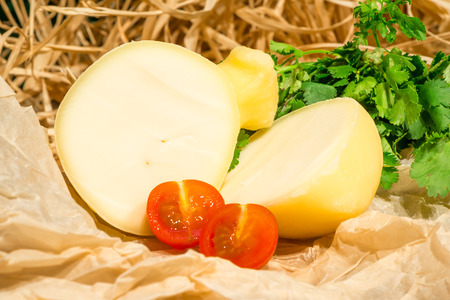 Italian cheese scamorza close-up on the table Imagens