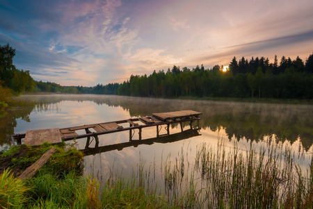 beautiful morning landscape with fog over the lake Imagens