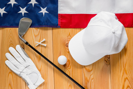american flags: Equipment for golf and an American flag on a wooden floor view from above