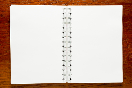 blank page: note pad with spiral close-up view from above