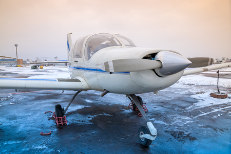 small plane: a small plane is at the airport in non-flying weather, winter