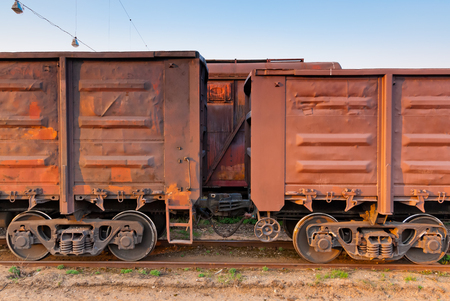 part of a long freight train is on the tracks