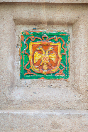 doubleheaded: image on the wall of the emblem of the Russian Federation. Double-headed eagle closeup Stock Photo