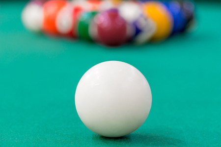cue: white cue ball close-up on green cloth Stock Photo