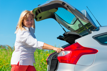 hatchback: Woman closes the trunk of the car type hatchback Stock Photo