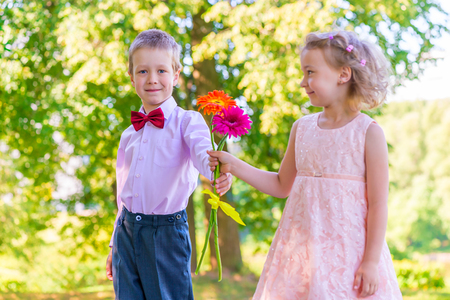 baby girls: Groom gives a little girl a bouquet of flowers