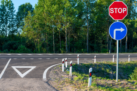 obligatory: obligatory stop sign at an intersection on a country road Stock Photo