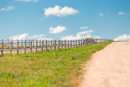 beautiful location: wooden fence on a ranch in a beautiful location Stock Photo