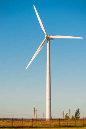 renewable energy resources: the windmill close-up in a sunny summer day