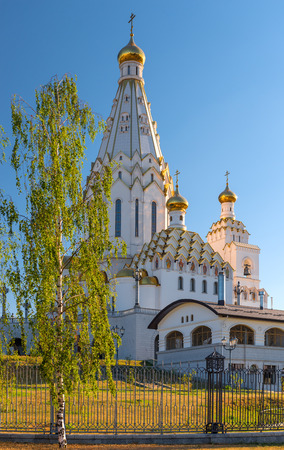 domes: White All Saints Church with golden domes in Minsk, Belarus Stock Photo