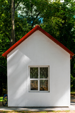 small roof: small white house with a red roof Stock Photo