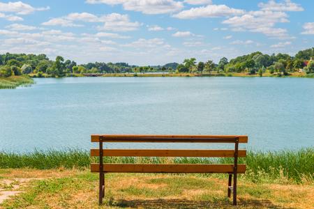 empty bench: beautiful summer landscape. Empty bench near the lake Stock Photo