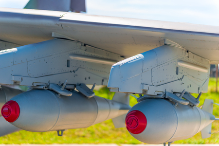 aerial bomb: two bombs on military aviation bomber closeup