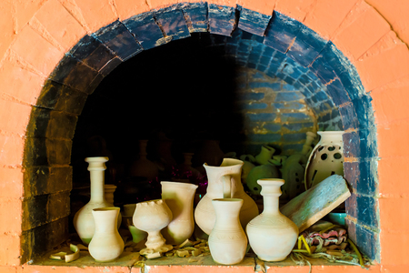 pottery in a kiln in the pottery workshop Stock Photo