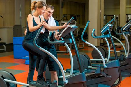 teaches: coach teaches an athlete in training in the gym