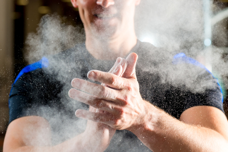talcum: male hands smeared talcum powder close up Stock Photo