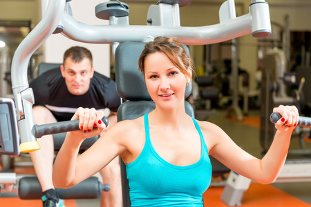 simulators: couple on simulators in the gym spends leisure Stock Photo