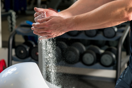 talc: talc in male hands in gym close up