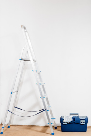 stepladder: stepladder and tools for repair in the house